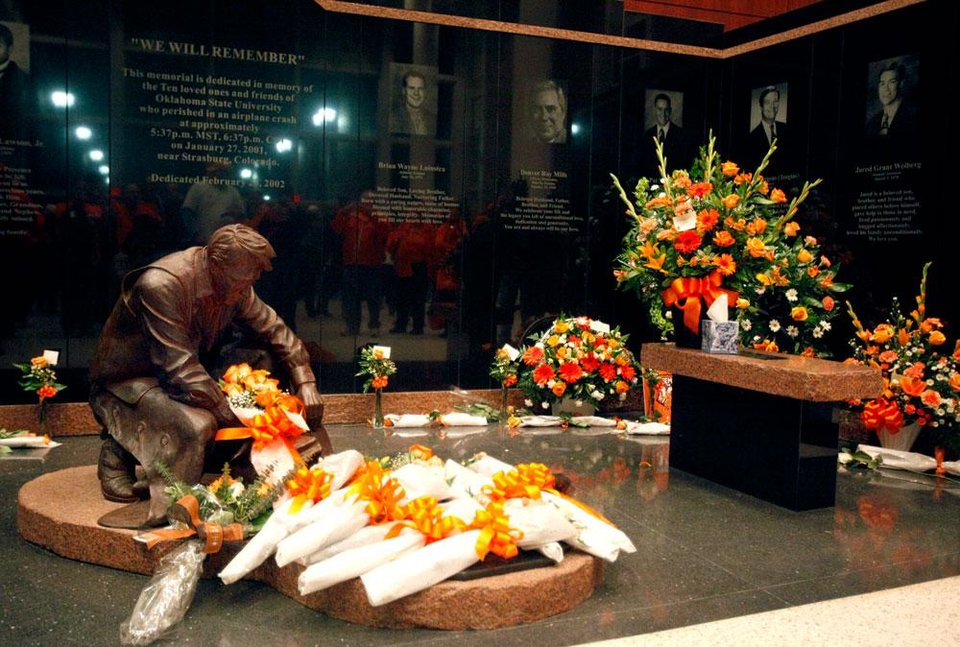 Photo -  A view of the memorial to the victims of the OSU plane crash, after the basketball game between Oklahoma State and Texas, Wednesday, Jan. 26, 2011, at Gallagher-Iba Arena in Stillwater, Okla. Photo by Sarah Phipps, The Oklahoman