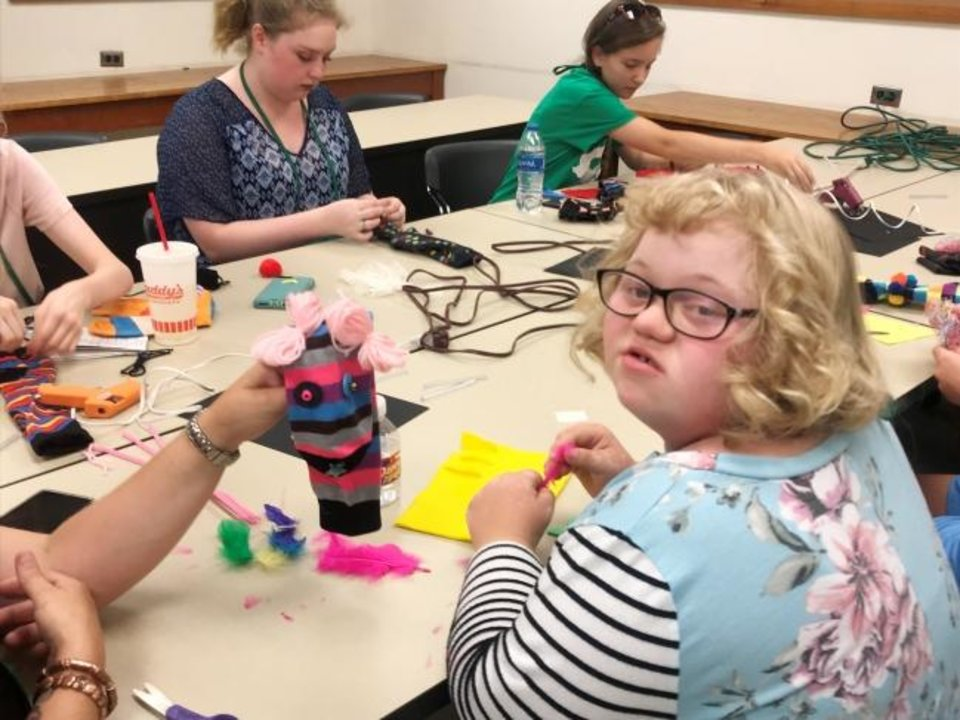Photo -  4-H members from across the state gather for a crazy sock puppet workshop at State 4-H Roundup held this past summer in July. [PHOTO PROVIDED]