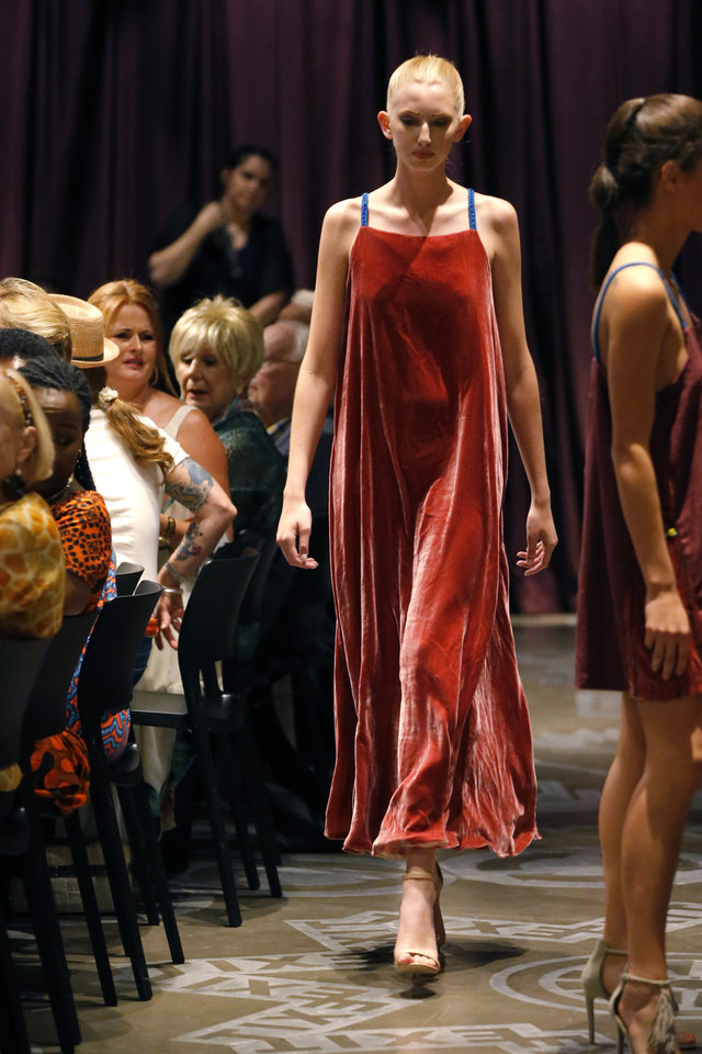 Photo -  A gown by Chandler Craven, of the Oklahoma State University department of design, housing and merchandising, features candy-colored silk velvet and unstructured design. [PHOTO BY BRYAN TERRY, THE OKLAHOMAN]