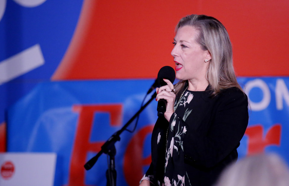 Photo -  House 5th District candidate Kendra Horn speaks during the Vote Common Good Bus Tour last week at Wiley Post Park in Oklahoma City. [Photo by Sarah Phipps, The Oklahoman]