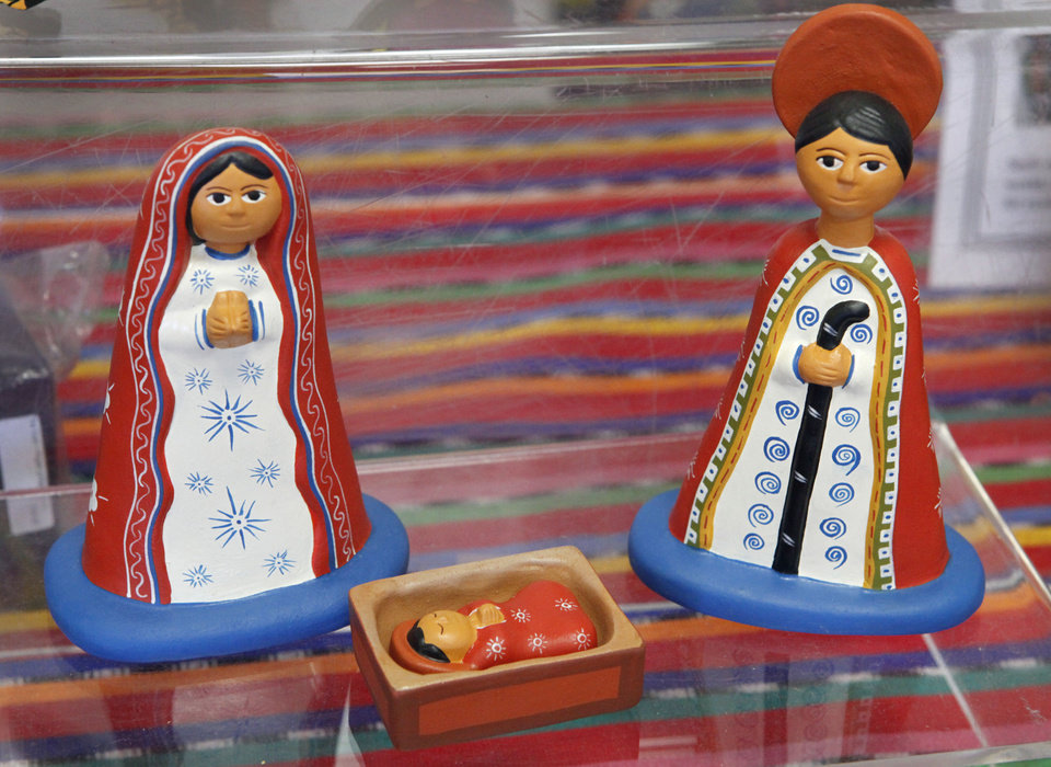 Photo - This Nativity scene from Peru is one of the items for sale at  Pambe Ghana Market. Photo By David McDaniel, The Oklahoman.  David McDaniel - The Oklahoman
