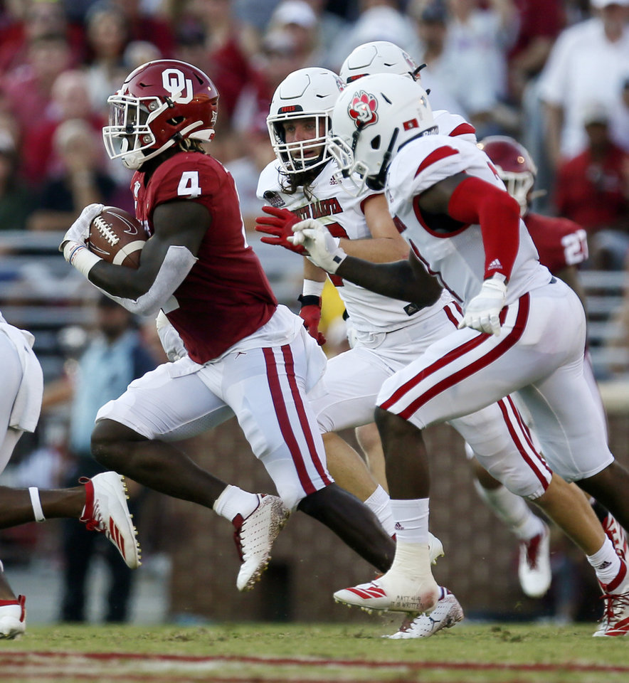Photo - Oklahoma's Trey Sermon (4) carries the ball during a college football game between the Oklahoma Sooners (OU) and South Dakota Coyotes at Gaylord Family - Oklahoma Memorial Stadium in Norman, Okla., Saturday, Sept. 7, 2019. [Nate Billings/The Oklahoman]