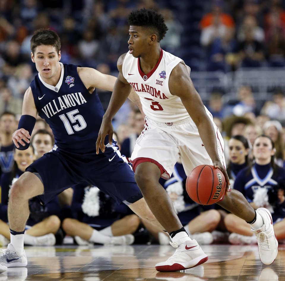 Photo - Oklahoma's Christian James (3) dribbles against Villanova's Ryan Arcidiacono (15) during the national semifinal between the Oklahoma Sooners (OU) and the Villanova Wildcats in the Final Four of the NCAA Men's Basketball Championship at NRG Stadium in Houston, Saturday, April 2, 2016. Photo by Nate Billings, The Oklahoman