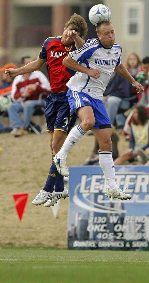 Photo - MAJOR LEAGUE SOCCER: Kansas City's Jack Jewsbury, right, gets to a header in front of Real Salt Lake's Carey Talley in the first half during the MLS exhibition soccer game between the Kansas City Wizards and Real Salt Lake at John Crain Field in Norman Okla., Saturday, March 22, 2008. BY MATT STRASEN, THE OKLAHOMAN ORG XMIT: KOD