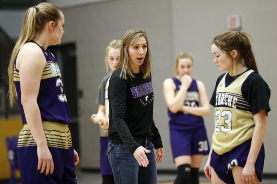 Photo -  Okarche coach Kelli Jennings, center, talks to Raegan Robinson, right, and Kelsee Brown during practice on Monday. Okarche plays Vici in the first round of the Class A state basketball tournament on Thursday at Southern Nazarene University in Bethany. [Nate Billings/The Oklahoman]