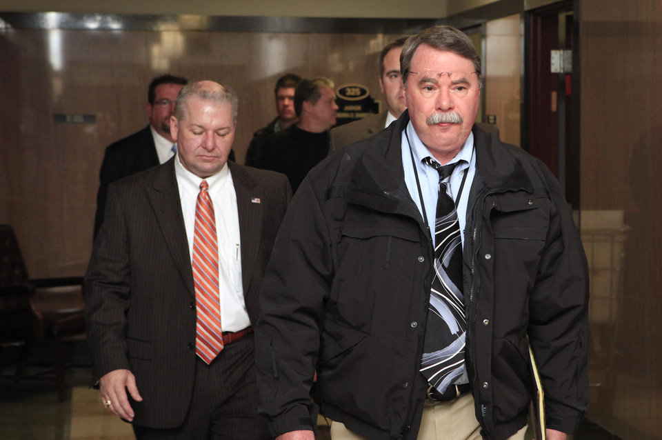 Photo - Oklahoma County District Attorney David Prater, left, and Oklahoma City police detective Mike Veasey arrive at the state's multicounty grand jury on March 29.   PAUL B. SOUTHERLAND - PAUL B. SOUTHERLAND