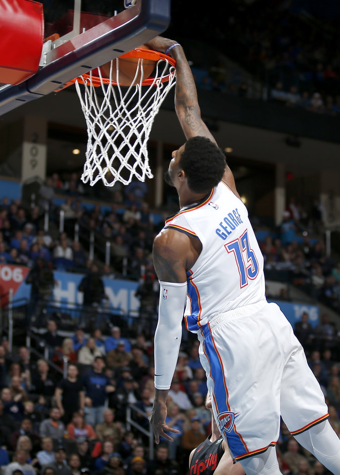 Photo - Oklahoma City's Paul George (13) goes up for a dunk during the NBA basketball game between the Oklahoma City Thunder and the Portland Trail Blazers at Chesapeake Energy Arena in Oklahoma City, Tuesday, Jan. 22, 2019. Photo by Sarah Phipps, The Oklahoman