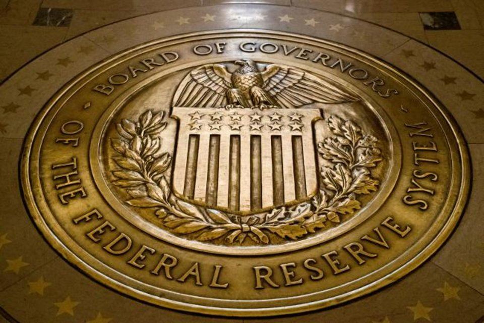 Photo -  The seal of the Board of Governors of the United States Federal Reserve System is shown at the Marriner S. Eccles Federal Reserve Board Building in Washington. [AP PHOTO]