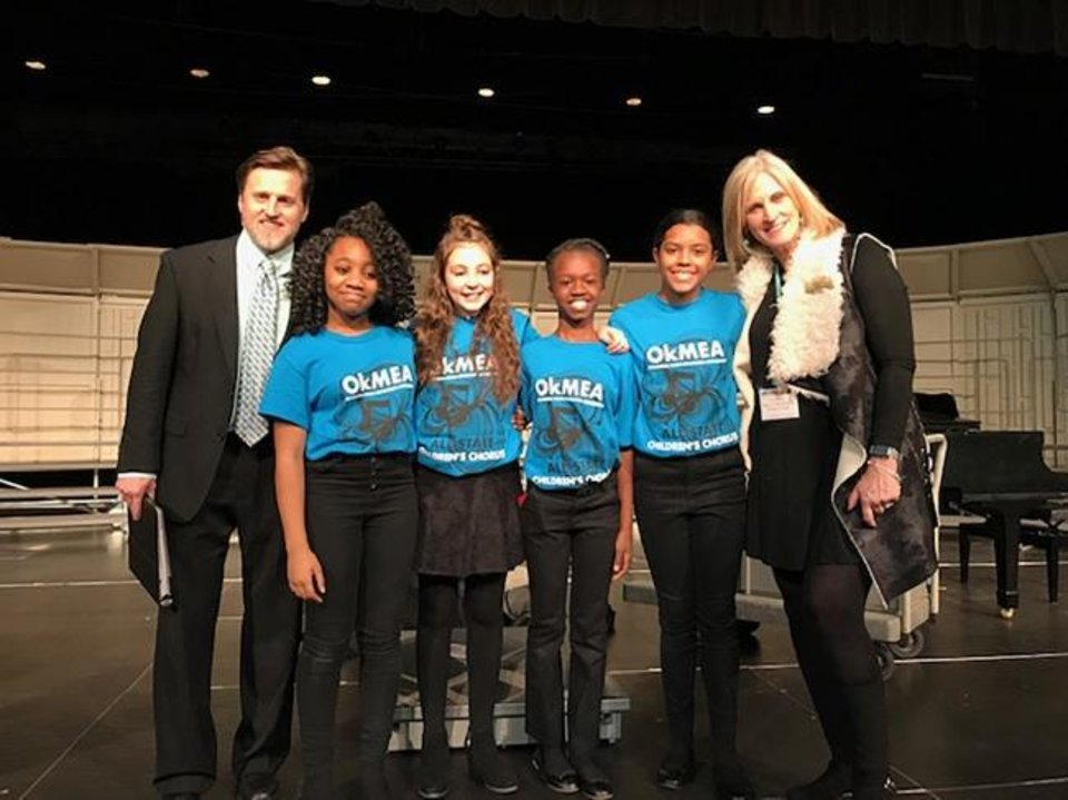 Photo -  Heritage Hall Middle School choir students who attended All-State included Amber Banks, Emilee Chard, Kaitlyn Marks and Addison Littlejohn, along with music directors David Hillis, far left, and Cristi Miller, at right. [PHOTO PROVIDED]
