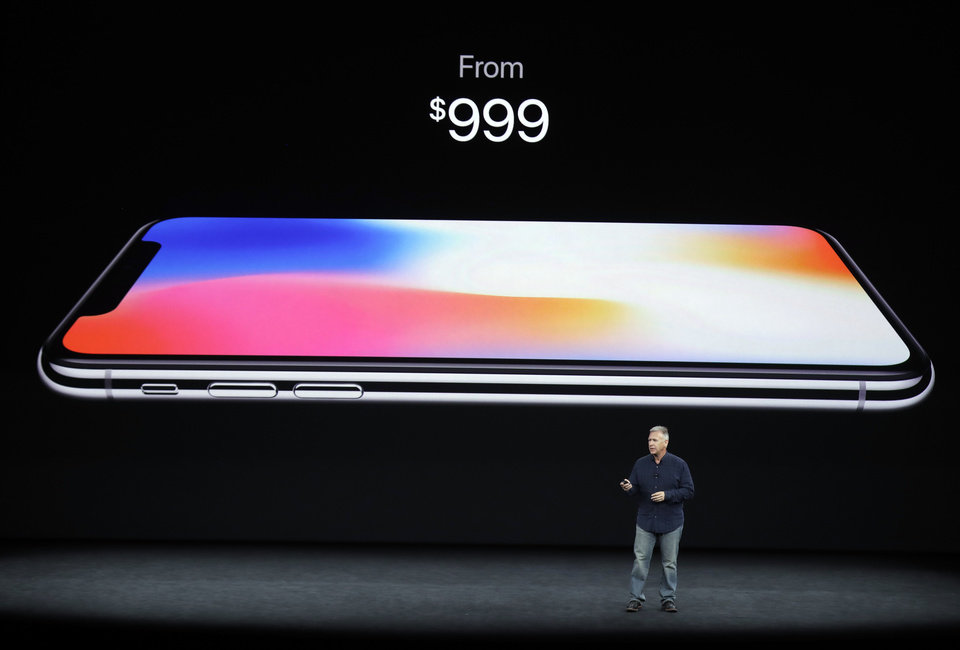 Photo - Phil Schiller, Apple's senior vice president of worldwide marketing, discusses features of the new iPhone X at the Steve Jobs Theater on the new Apple campus on Tuesday, Sept. 12, 2017, in Cupertino, Calif. (AP Photo/Marcio Jose Sanchez)