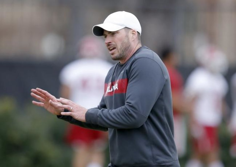 Photo -  Oklahoma defensive coordinator Alex Grinch reeled in some strong recruits on signing day. [Sarah Phipps/The Oklahoman]
