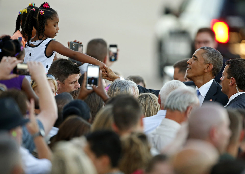 Photo - President Barack Obama shakes hands with Aiyana Jones, 5, of Lawton after arriving on Air Force One at Tinker Air Force Base in Midwest City, Wednesday, July 15, 2015. President Barack Obama will visit the Federal Correctional Institution El Reno, where he will meet with Oklahoma law enforcement officials and inmates and conduct an interview for a documentary scheduled to air in the fall. Photo by Bryan Terry, The Oklahoman