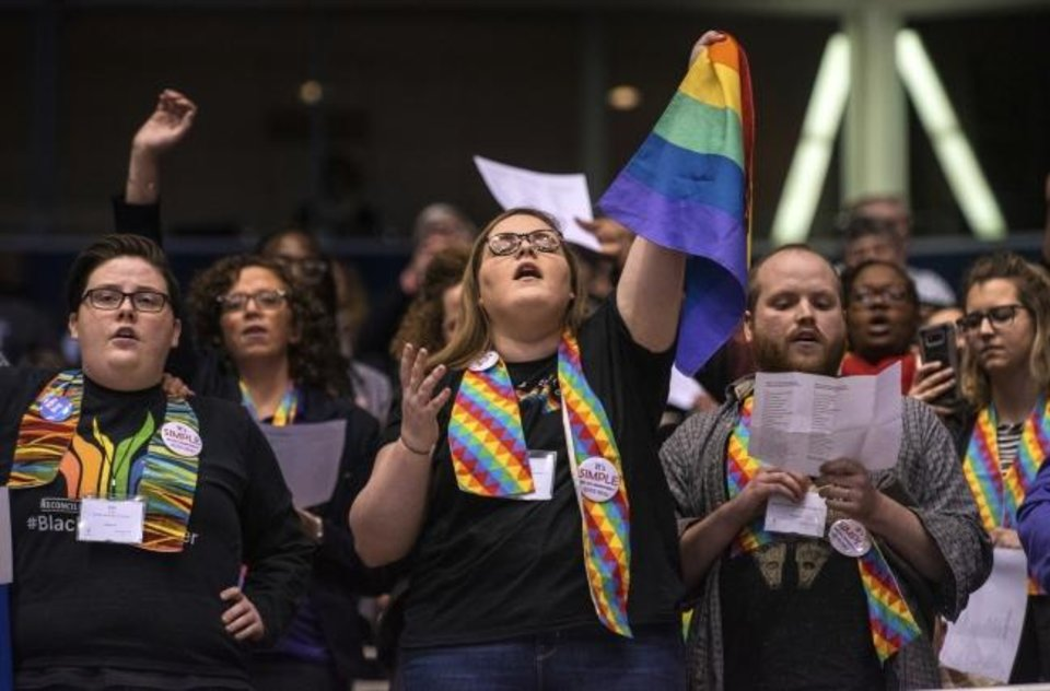 Photo -  Shelby Ruch-Teegarden, center, of Garrett-Evangelical Theological Seminary joins other protestors during the United Methodist Church's special session of the general conference on Feb. 26  in St. Louis. [AP File Photo]