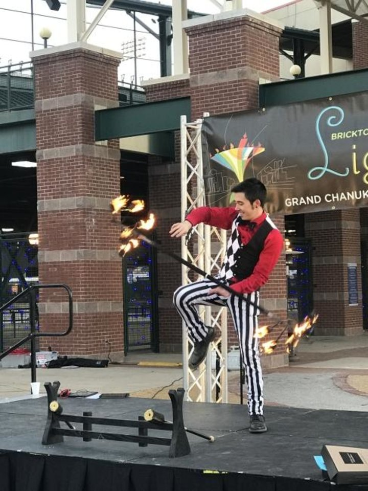 Photo -  Bryan Sekine shares his skills as a fire performer with the crowd at the