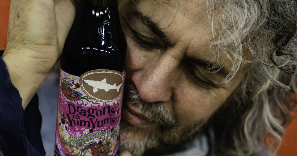 Photo - Wayne Coyne, frontman of Oklahoma City-based psychedelic rockers The Flaming Lips, cradles a bottle of Dragons & YumYums, the limited-edition beer the band has partnered with Dogfish Head Craft Brewery in Delaware to create. Dogfish Head Craft Brewery photo