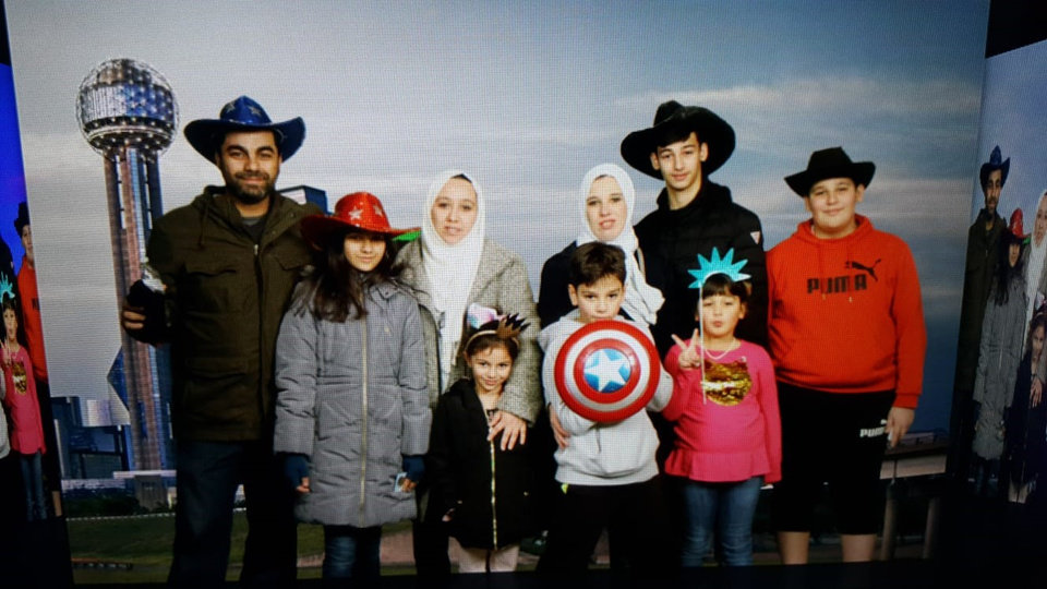 Photo -  Jenan Ayesh, third from left, poses for a photo with her family members during a recent visit to Reunion Tower in Dallas. [Photo provided]