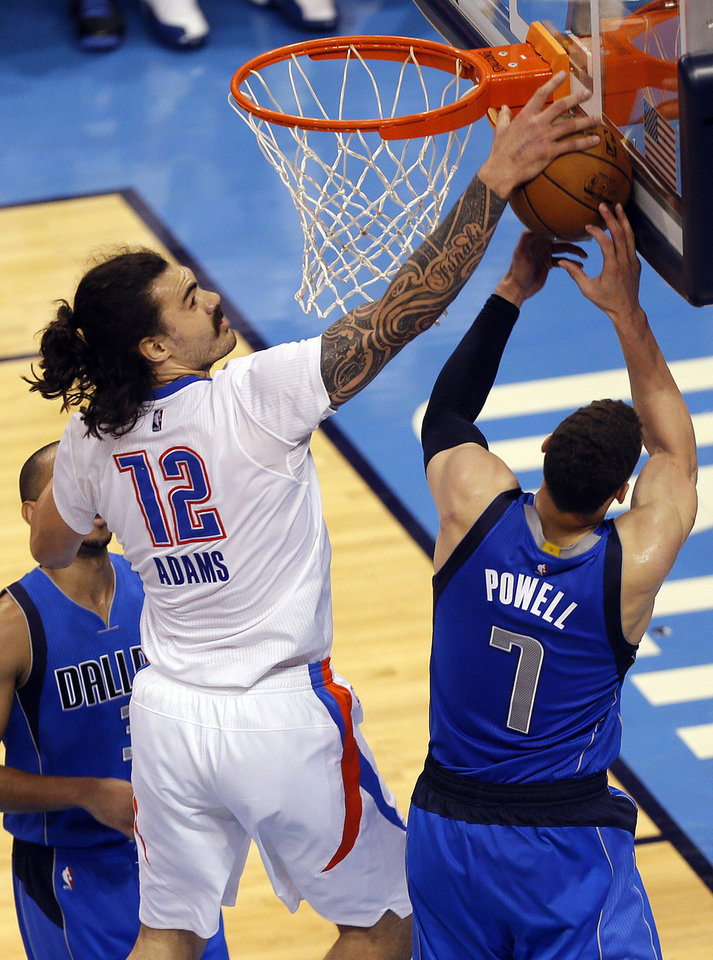 Photo - Oklahoma City's Steven Adams (12) defends against Dallas' Dwight Powell (7) during Game 5 of the first round series between the Oklahoma City Thunder and the Dallas Mavericks in the NBA playoffs at Chesapeake Energy Arena in Oklahoma City, Monday, April 25, 2016. Photo by Sarah Phipps, The Oklahoman