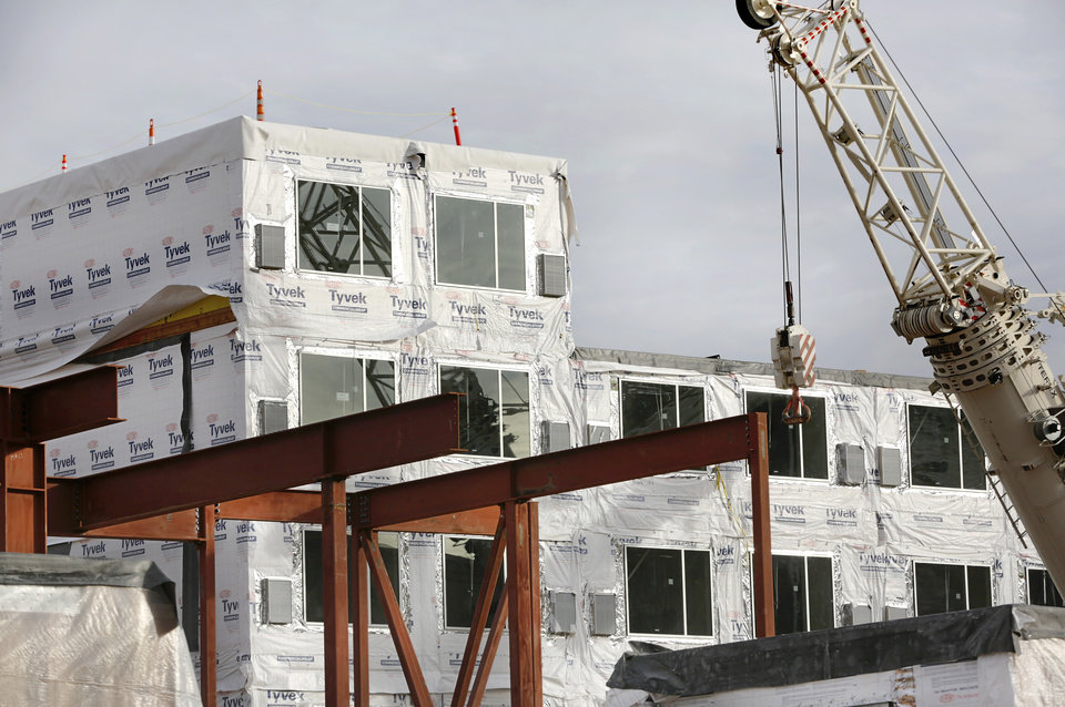 Photo -  Several pre-fabricated hotel rooms were stacked up at the future AC Hotel over the past few days. [Photo by Jim Beckel, The Oklahoman]