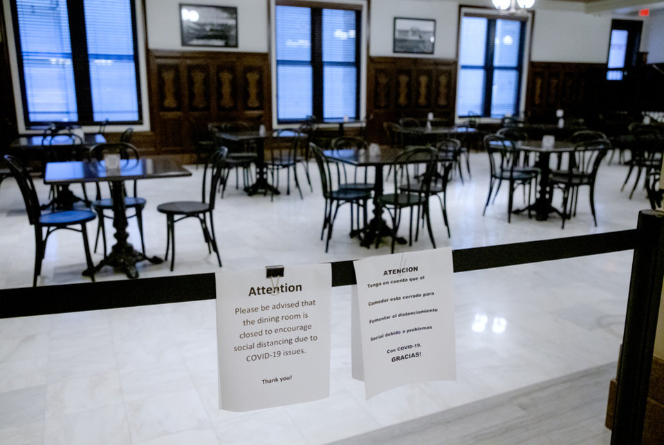 Photo - A sign posted inside the Oklahoma state Capitol closing the dinning room as the Capitol reopened to the public, and for legislative business on Monday, May 4, 2020, in Oklahoma City, Okla. after being closed due to the Coronavirus Pandemic.[Chris Landsberger/The Oklahoman]