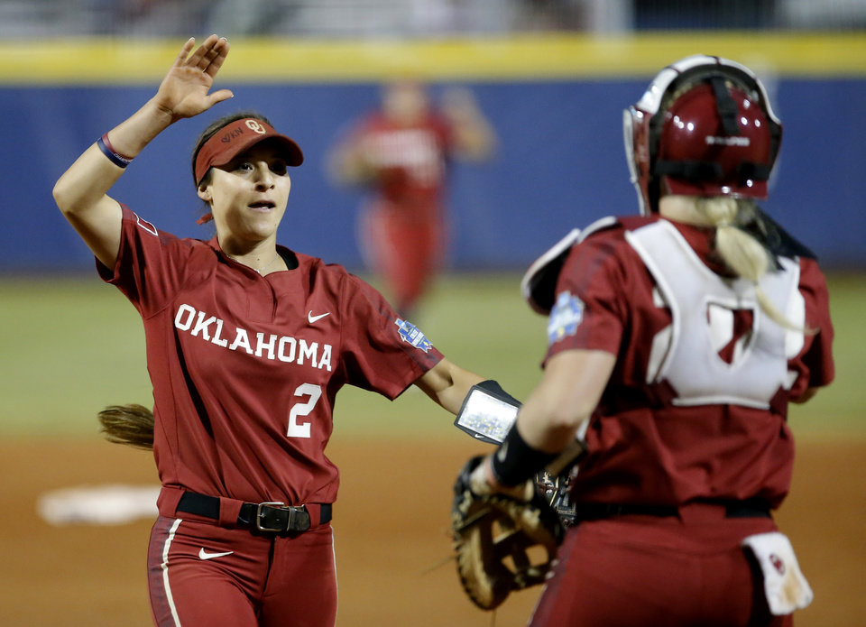 Photo - Oklahoma's Sydney Romero (2) celebrates the Sooners' win over Oklahoma State with Lynnsie Elam (22) following a Women's College World Series between Oklahoma State (OSU) and Oklahoma at USA Softball Hall of Fame Stadium in Oklahoma City,  Friday, May 31, 2019.  [Sarah Phipps/The Oklahoman]