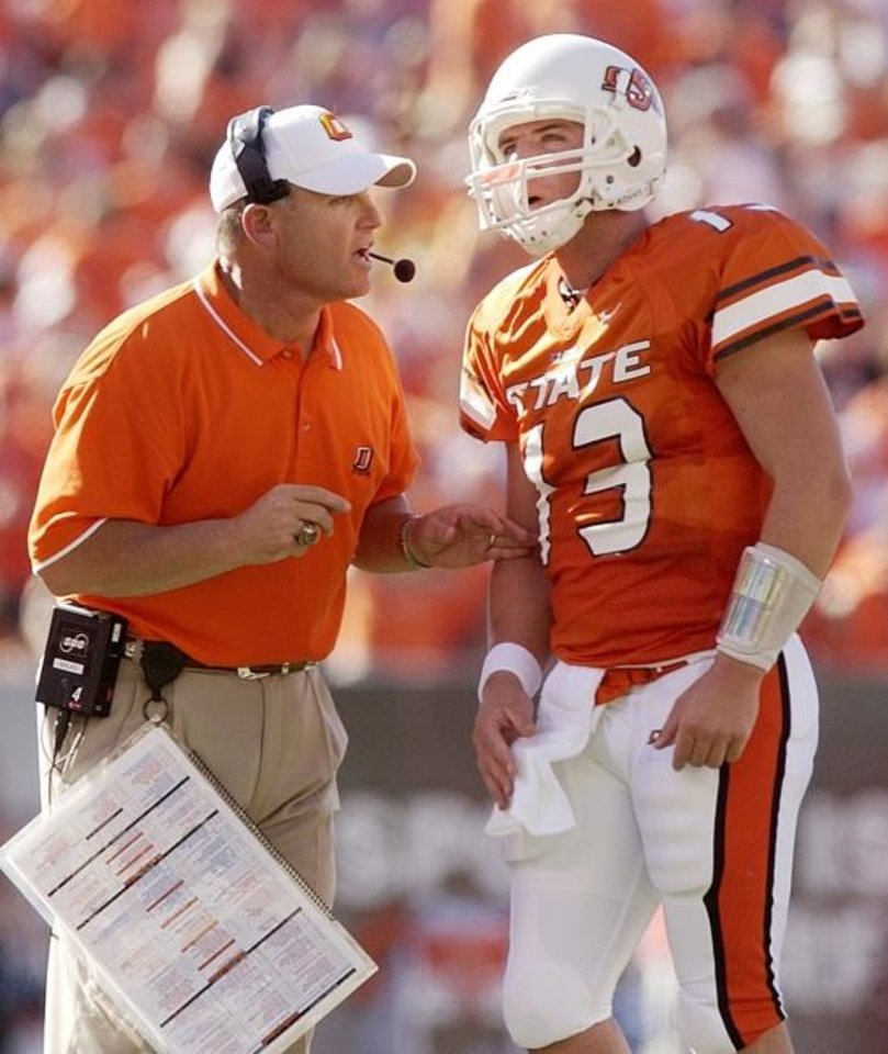 Photo -  OSU head coach Les Miles talks with quarterback Josh Fields in 2003. [Nate Billings/The Oklahoman Archives]