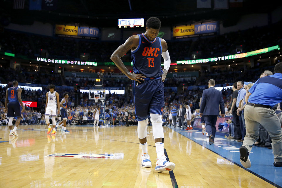 Photo - Oklahoma City's Paul George (13) walks off the court after getting a foul during an NBA basketball game between the Oklahoma City Thunder and the Sacramento Kings at Chesapeake Energy Arena in Oklahoma City, Sunday, Oct. 21, 2018. Photo by Bryan Terry, The Oklahoman