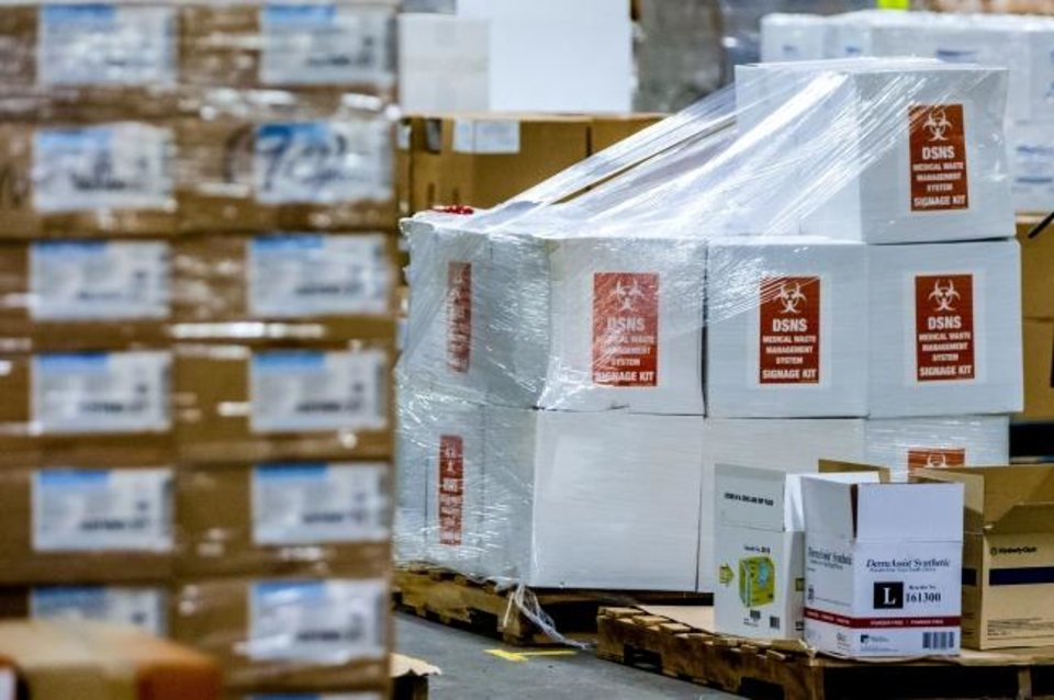 Photo -  Boxes of personal protection equipment (PPE) and medical supplies sit in a warehouse in Oklahoma City where the state has amassed a stockpile for its COVID-19 response. [Chris Landsberger/The Oklahoman]