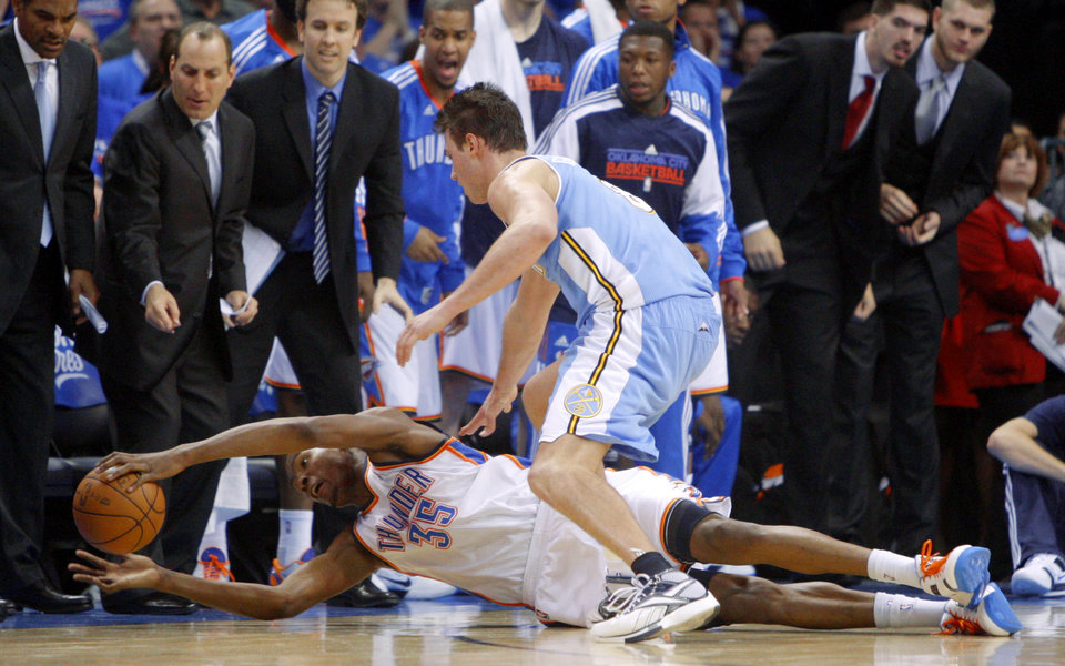 Photo - Oklahoma City's Kevin Durant (35) dives for the ball beside Denver's Danilo Gallinari (8) during the NBA basketball game between the Denver Nuggets and the Oklahoma City Thunder in the first round of the NBA playoffs at the Oklahoma City Arena, Sunday, April 17, 2011. Photo by Bryan Terry, The Oklahoman