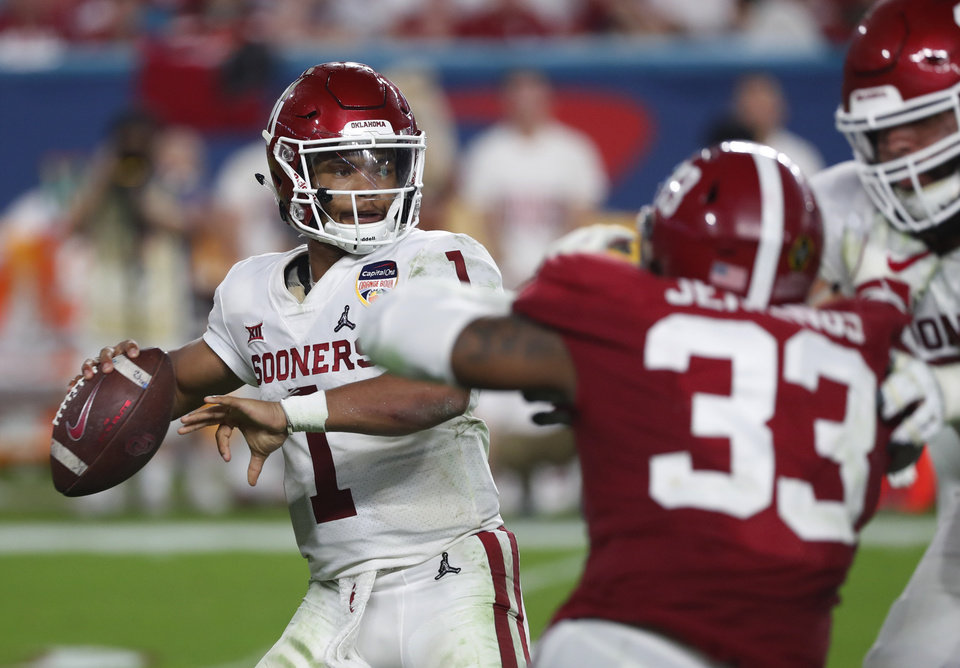 Photo - Oklahoma quarterback Kyler Murray (1) looks to pass, during the second half of the Orange Bowl NCAA college football game against Alabama, Saturday, Dec. 29, 2018, in Miami Gardens, Fla. (AP Photo/Wilfredo Lee)