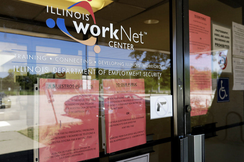 Photo -  Information signs are displayed June 11 at the closed Illinois Department of Employment Security WorkNet center in Arlington Heights, Ill. U.S. employers advertised for slightly fewer jobs in August while their hiring ticked up modestly. [Nam Y. Huh/Associated Press file photo]