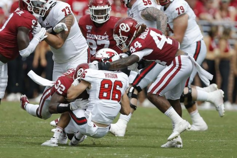 Photo -  Oklahoma's Brendan Radley-Hiles (44) is called for a faccemask penalty against Texas Tech's Dalton Rigdon (86) during the Sept. 28 game in Norman. The Sooners are one of the most penalized teams in the nation. [Bryan Terry/The Oklahoman]