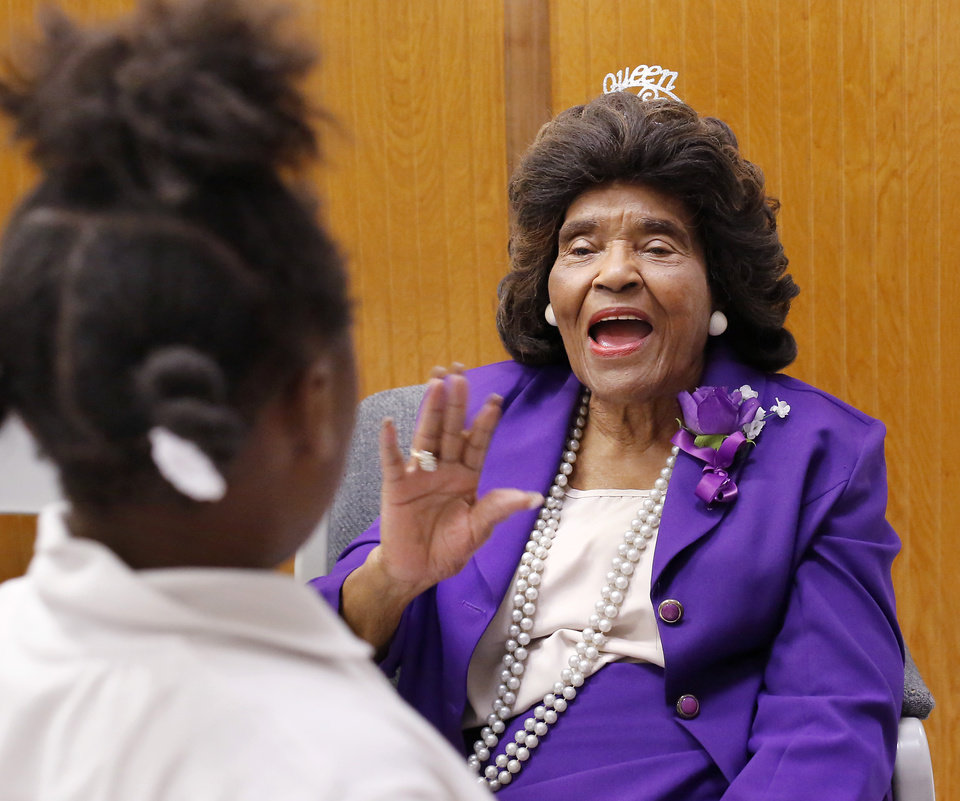 Photo - Thelma Parks waves to a student leaving the auditorium at the end of the assembly where Parks was honored. The school that bears her name, Thelma Parks Elementary School, is celebrating its 20th anniversary with special guests that included Parks,  a former teacher and school board member, and Thurman White Jr., a 2017 Foundation for Oklahoma City Public Schools Wall of Fame inductee who had Parks as a teacher. The event was held  in the school's auditorium on Thursday, Nov. 2, 2017.  Photo by Jim Beckel, The Oklahoman