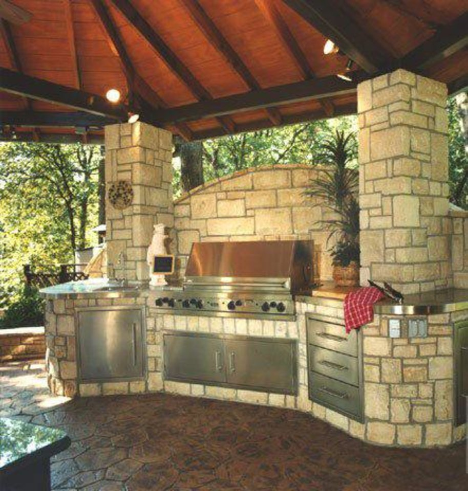 Photo - Left: An outdoor kitchen begs for guests. Photo provided by A Karen Black Co.