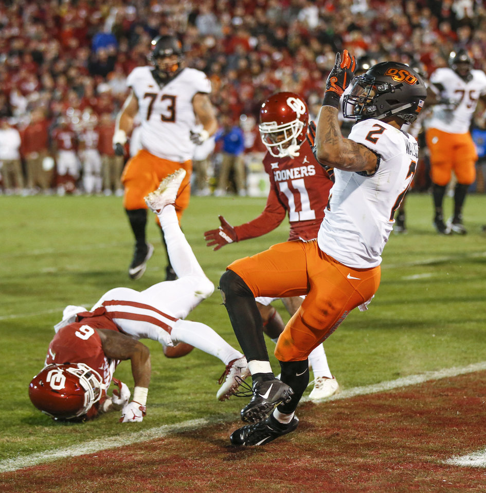 Photo - The pass intended for Oklahoma State's Tylan Wallace (2) is incomplete as Oklahoma's Tre Brown (6) defends near and Parnell Motley (11) on a two-point conversion after OSU's final touchdown during a Bedlam college football game between the University of Oklahoma Sooners (OU) and the Oklahoma State University Cowboys (OSU) at Gaylord Family-Oklahoma Memorial Stadium in Norman, Okla., Nov. 10, 2018. OU won 48-47. Photo by Nate Billings, The Oklahoman