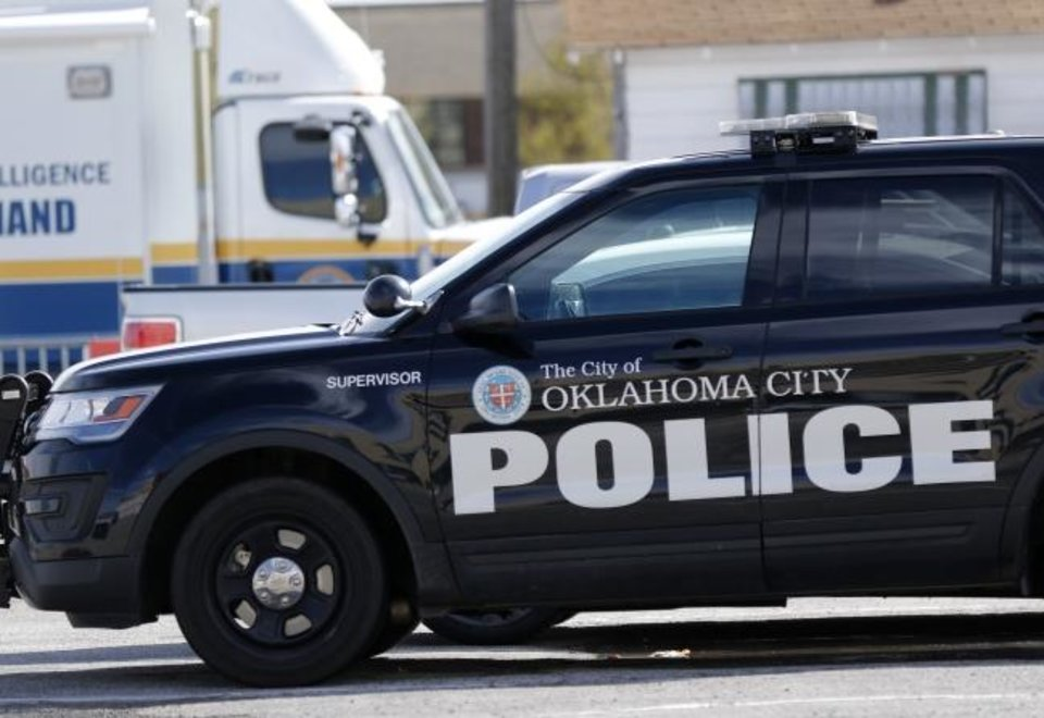 Photo - Police unit parked outside of the Oklahoma City Police Headquarters, downtown, Thursday, March 19, 2020.  [Photo by Doug Hoke/The Oklahoman]