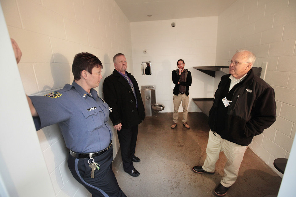 Photo - Oklahoma State Reformatory guard Tiffanie McGill, warden Tracy McCollun, reporter Graham Brewer and State Representative Bobby Cleveland visit in one of the cell during a tour of the facility, Tuesday, Oklahoma, November 12, 2013. Photo by David McDaniel, The Oklahoman  David McDaniel - The Oklahoman