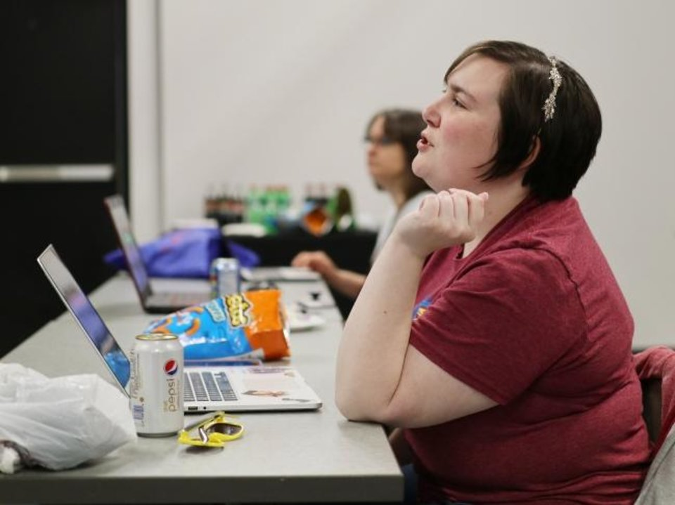 Photo -  Carmen Long listens to a speaker at a SheCodes meeting in January. [Doug Hoke/The Oklahoman]