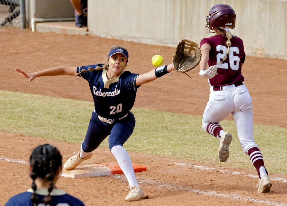 Photo - Southmoore's Kaylee Carter (20) gets the out on Jenks' Dacia Sexton (26) during the high school state championship fast pitch softball quarterfinals at ASA Hall of Fame Stadium in Oklahoma City, Okla. on Thursday, Oct. 15, 2020. [Chris Landsberger/The Oklahoman]