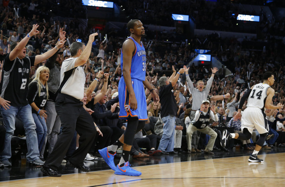 Photo - San Antonio fans celebrate behind Oklahoma City's Kevin Durant (35) after San Antonio's Danny Green (14) made a 3-pointer during Game 5 of the second-round series between the Oklahoma City Thunder and the San Antonio Spurs in the NBA playoffs at the AT&T Center in San Antonio, Tuesday, May 10, 2016. Oklahoma City won 95-91. Photo by Bryan Terry, The Oklahoman