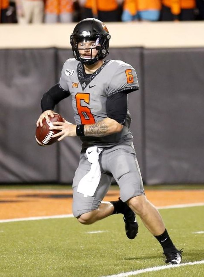 Photo - Oklahoma State quarterback Dru Brown took a unique journey from Los Gatos, California, to the College of San Mateo, to Hawaii and to the bench at OSU before reaching the primetime stage of Bedlam. [Sarah Phipps/The Oklahoman]