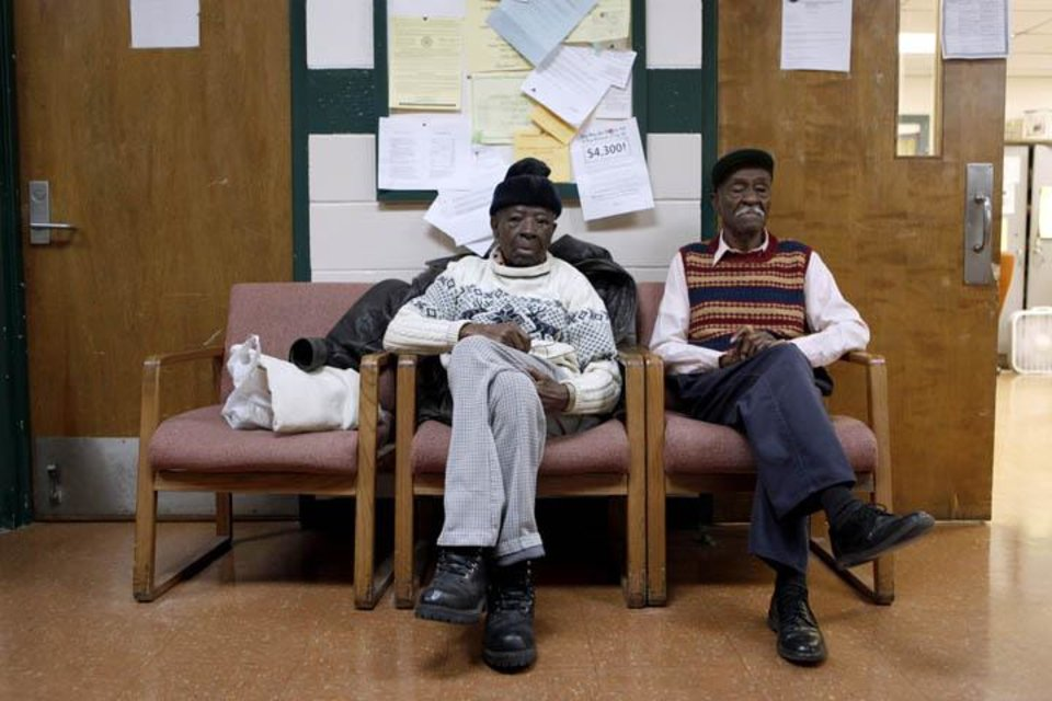 Photo -  A.C. Johnson, 99, left, and Odell Burton, 95, sit in the hallway of the Lincoln Senior Center, 4712 North Martin Luther King Avenue, Wednesday Jan. 13, 2009, in Oklahoma City. Photo by Sarah Phipps, The Oklahoman