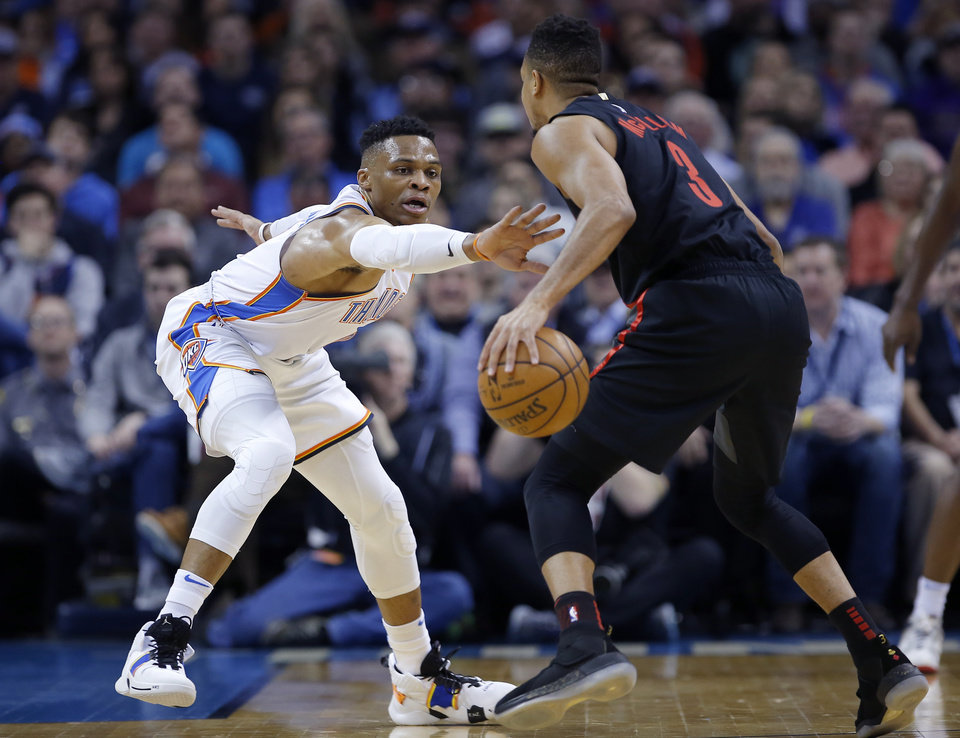 Photo - Oklahoma City's Russell Westbrook (0) defends against Portland's CJ McCollum (3) during the NBA basketball game between the Oklahoma City Thunder and the Portland Trail Blazers at Chesapeake Energy Arena in Oklahoma City, Tuesday, Jan. 22, 2019. Photo by Sarah Phipps, The Oklahoman