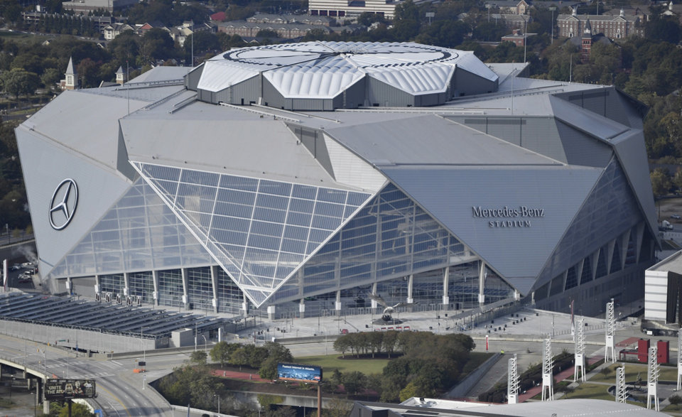 Photo - FILE - This Nov. 1, 2017, file photo shows the Mercedes-Benz stadium in Atlanta. Atlanta's new $1.5 billion stadium is about to be on perhaps its largest national stage for the Monday, Jan. 8, 2018, College Football Playoff title game, fans say the glitzy facility is living up to the hype despite a series of construction setbacks that delayed its opening. (AP Photo/Mike Stewart, File)