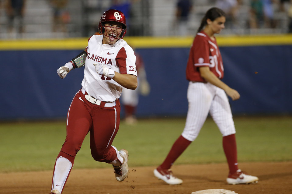 Photo - Oklahoma's Nicole Mendes (11) celebrates a home run in the 6th inning during a Women's College World Series between Oklahoma and Alabama at USA Softball Hall of Fame Stadium in Oklahoma City,  Sunday, June 2, 2019. Oklahoma won 7-3. [Sarah Phipps/The Oklahoman]