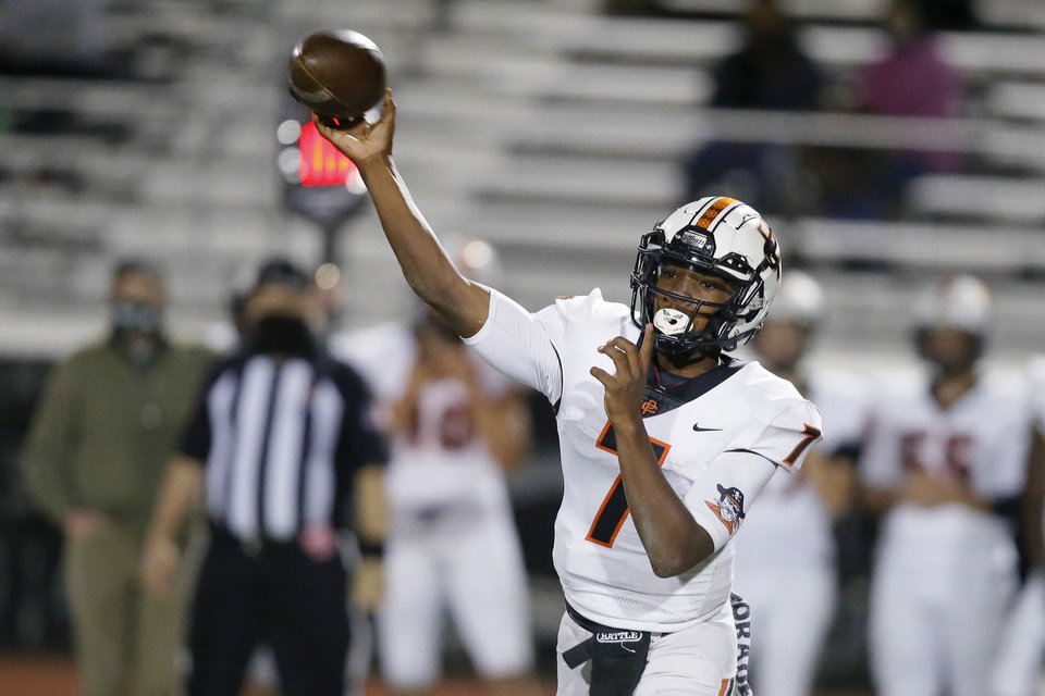 Photo - Putnam City's Marcellous Hawkins throws a pass during a high school football game between Norman North and Putnam City in Norman, Okla., Friday, Oct. 16, 2020. [Bryan Terry/The Oklahoman]