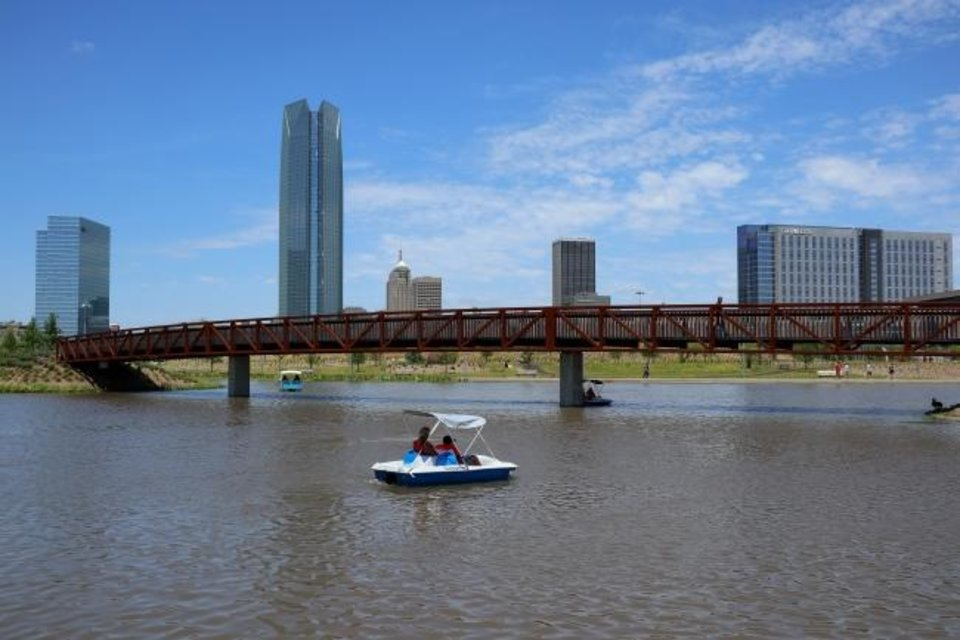 Photo -  Paddle boats return to the lake at Scissortail Park in downtown Oklahoma City. [Doug Hoke/The Oklahoman]