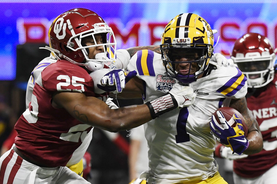 Photo - LSU wide receiver Ja'Marr Chase (1) runs against Oklahoma safety Justin Broiles (25) during the second half of the Peach Bowl NCAA semifinal college football playoff game, Saturday, Dec. 28, 2019, in Atlanta. (AP Photo/Danny Karnik)