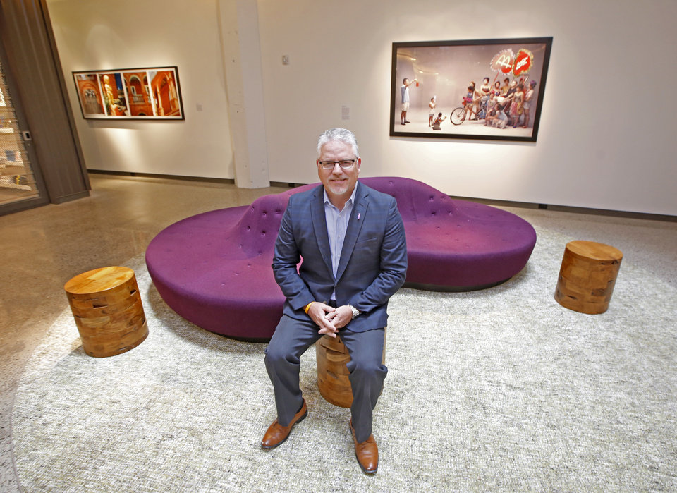 Photo -  Matt Cowden, general manager of 21c Museum Hotel, pauses in one of the art galleries in the hotel's lobby. [Photo By Steve Gooch, The Oklahoman]