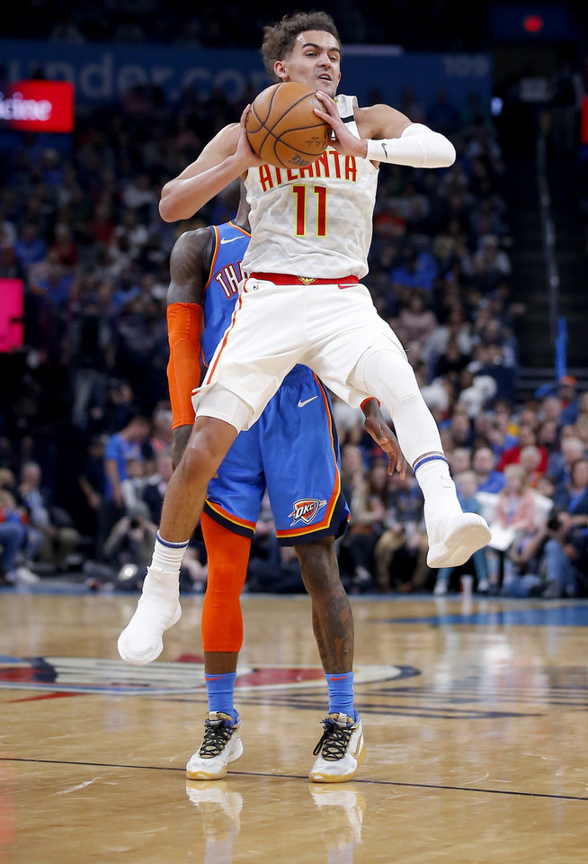 Photo - Atlanta's Trae Young (11) passes the ball  during the NBA basketball game between the Oklahoma City Thunder and the Atlanta Hawks at the Chesapeake Energy Arena in Oklahoma City,Friday, Jan. 24, 2020.  [Sarah Phipps/The Oklahoman]