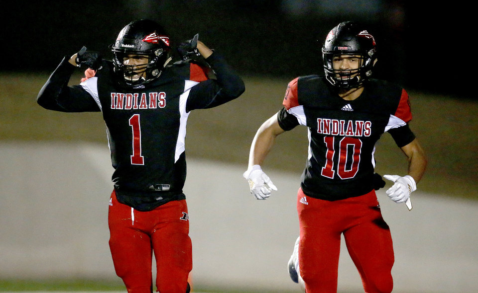 Photo - Plainview's Tyson Al-Jbour, left, and Morgan Pearson celebrate a touchdown during the high school football semifinal playoff game between Verdigris and Plainview at Noble High School in Noble, Okla., Friday, Nov. 29, 2019. [Sarah Phipps/The Oklahoman]